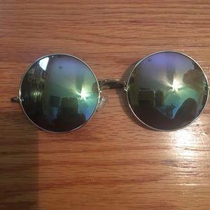 Accessories - Green mirrored circle sunglasses.